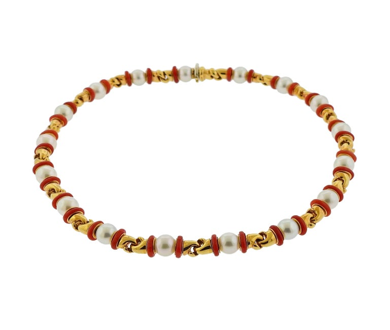 Classic Bulgari Doppio necklace, set in 18k yellow gold, featuring 7.8-8mm pearls and coral spacers. Necklace is 15.5