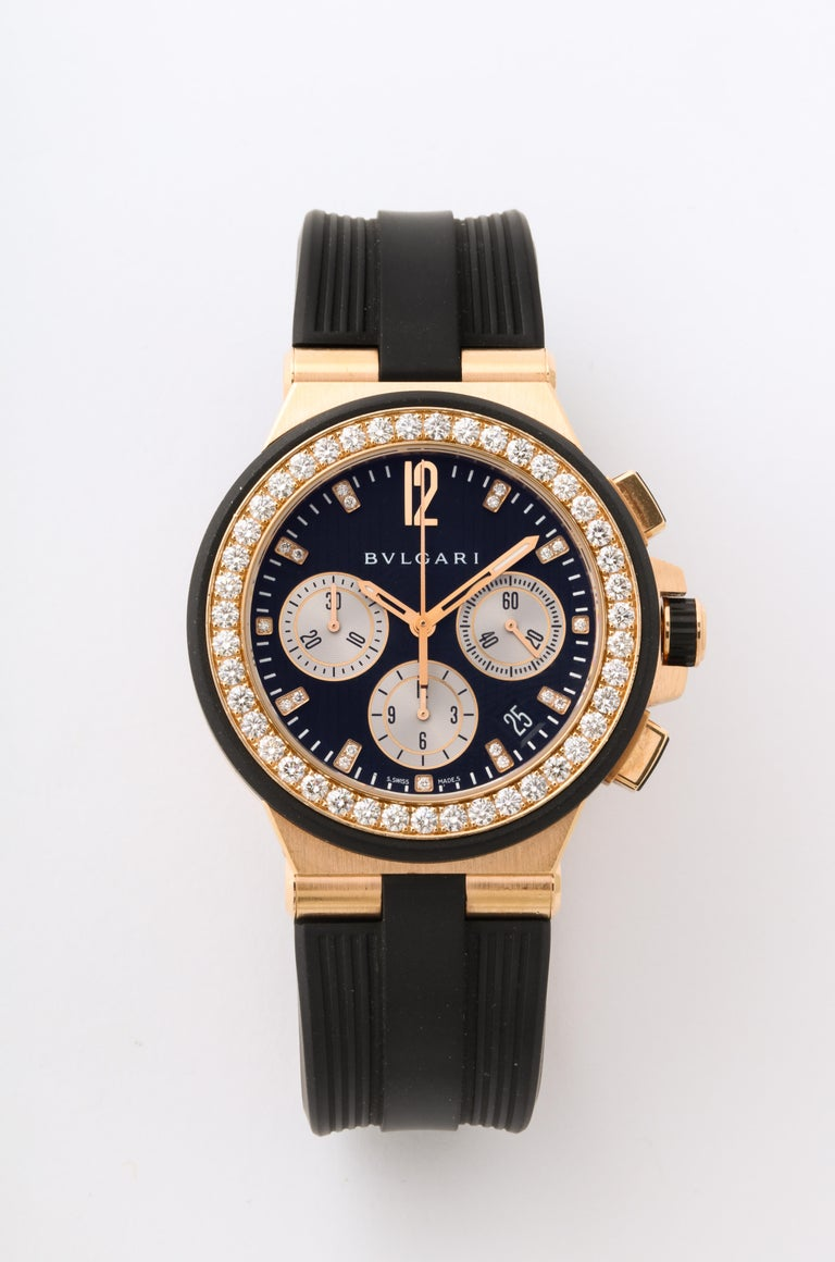 Pre-Owned Bulgari Diagono Chronograph automatic watch. 40mm 18k rose gold case with a diamond bezel and a black dial with diamond markers on a black rubber strap.  Functions: date, chronograph, hours, minutes, and small-seconds. Reference