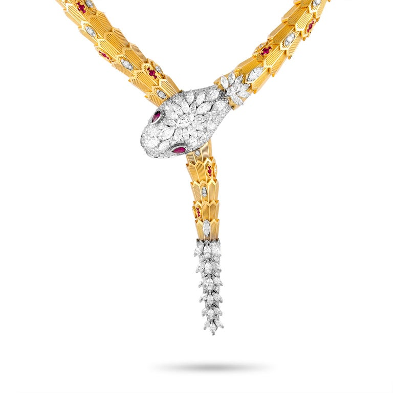 """The Bvlgari """"Serpenti"""" necklace is made out of 18K yellow and white gold and weighs 260.3 grams. It is set with diamonds that total 19.95 carats and with rubies that amount to 2.52 carats. The necklace measures 18.50"""" in length and boasts a 6"""""""