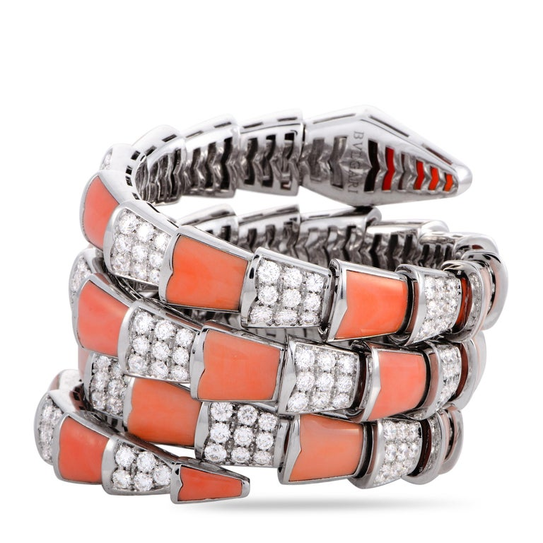 "The Bvlgari ""Serpenti"" bracelet is crafted from 18K white gold and embellished with corals and a total of 16.15 carats of diamonds that feature grade F color and VVS clarity. The bracelet weighs 175.3 grams and measures 7"" in length, boasting a"