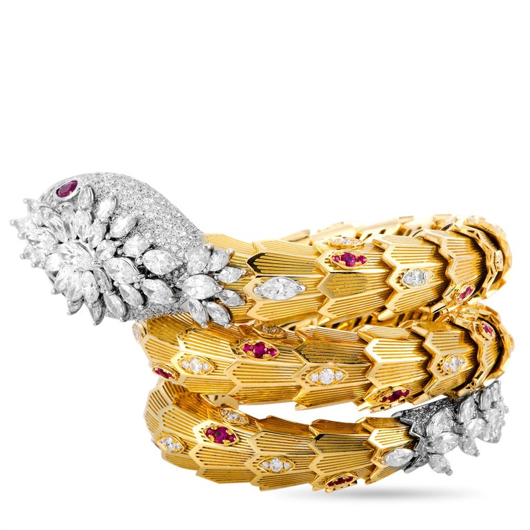 """The Bvlgari """"Serpenti"""" bracelet is made out of 18K yellow and white gold and weighs 231.5 grams. It is set with diamonds that total 18.90 carats and with rubies that amount to 1.64 carats. The bracelet measures 6.28"""" in length and boasts a 2"""""""