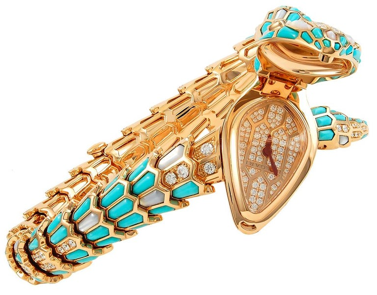 BULGARI Serpenti Secret 40mm Turquoise Watch in 18k Rose Gold. This 'Secret' bracelet watch is one of the latest renditions of the iconic Serpenti by Bulgari, dating from 2016. The timepiece features an articulated body fashioned in rose gold,