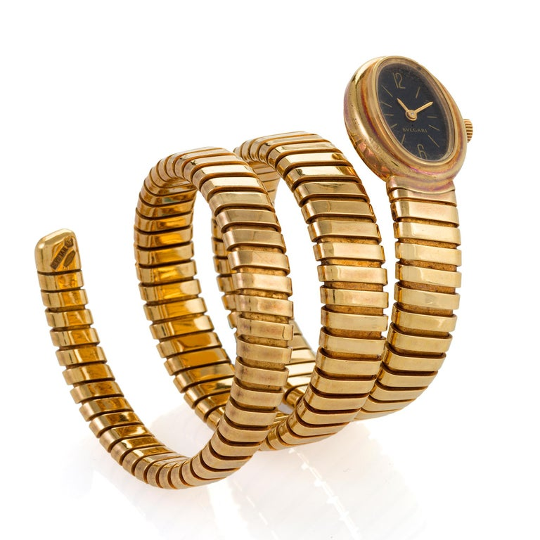 A refined and abstract design by Bulgari, Rome, this 1970s Serpenti watch is set into a coiled bracelet composed of highly flexible gold. Designed to wrap like a serpent around the arm, the spiraling bracelet is formed of tubogas links simulating