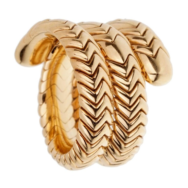 An iconic Bulgari Spiga with a chevron-link, flexible wrap ring in 18k yellow gold.   Size 6