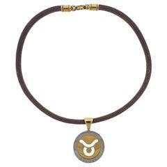 Bulgari Tondo Taurus Zodiac Sign Gold and Steel Pendant Cord Necklace