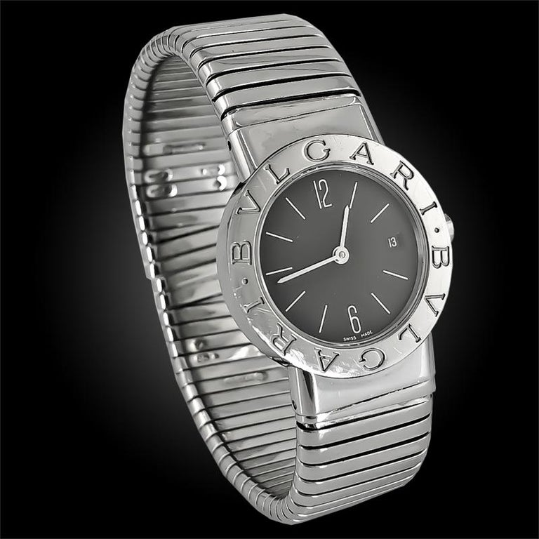 A vintage and estate collection piece by Bulgari,  comprising a stainless steel Tubogas watch designed as a cuff, featuring the iconic double Bulgari logo engraved around the dial.    Signed Bulgari
