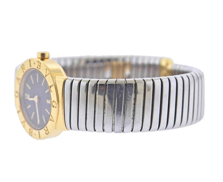 Classic 18k gold and steel Tubogas bracelet watch by Bvlgari, with black dial and quartz movement. Bracelet will fit approx. 7