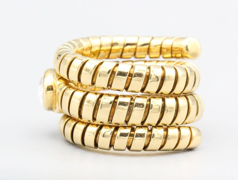 Bulgari Tubogas Oval Diamond and 18 Karat Yellow Gold Flexible Snake Ring In Excellent Condition For Sale In New York, NY