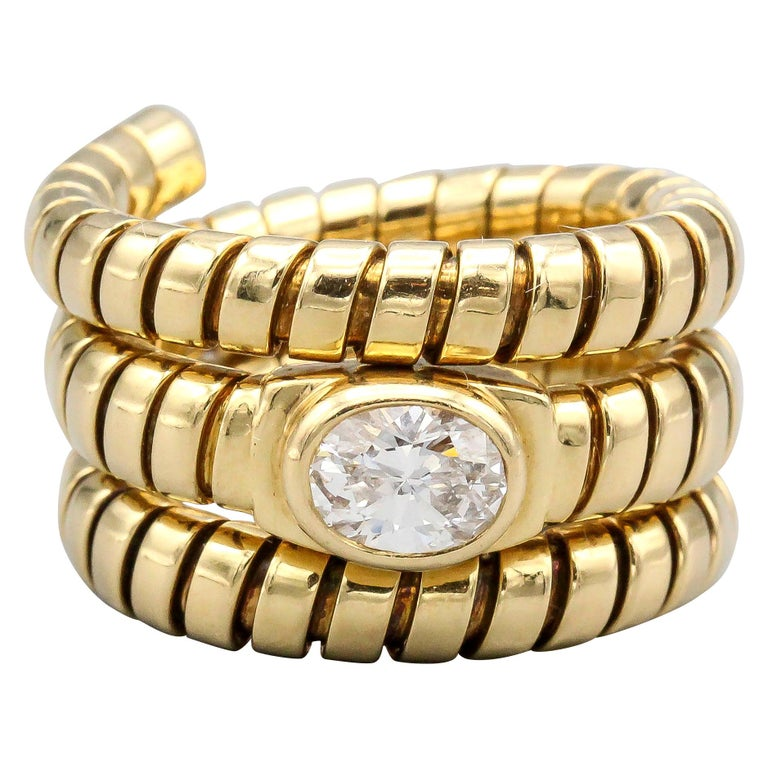 Bulgari Tubogas Oval Diamond and 18 Karat Yellow Gold Flexible Snake Ring For Sale