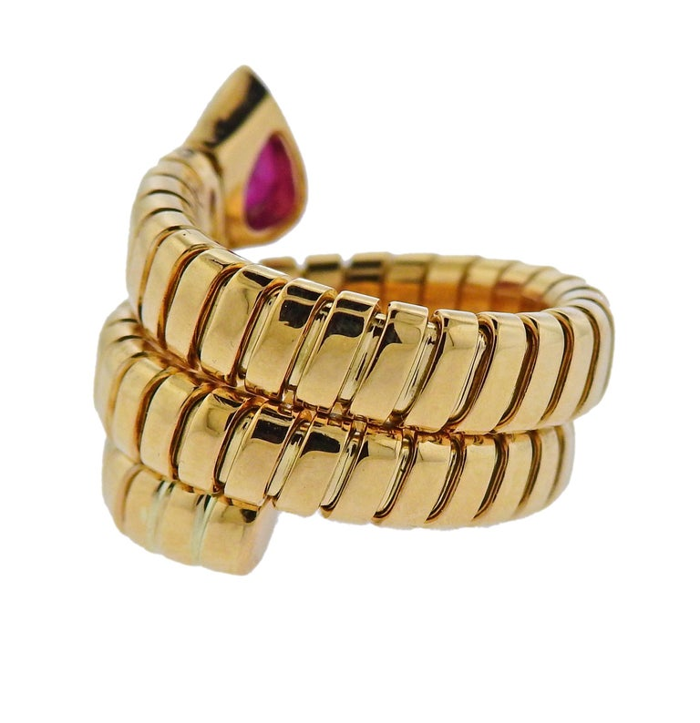 18k yellow gold wrap ring crafted by Bulgari for the Tubogas collection. Features ruby.  Ring size 6 (slightly flexible) width- 18mm wide. Weighs 16.2 grams.  Marked: Bulgari 750 Italian Marks.