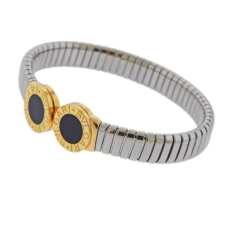 Classic Tubogas 18k gold and stainless steel cuff bracelet by Bvlgari, set with onyx. Bracelet will fit approx. 7