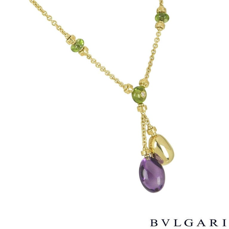 A beautiful 18k yellow gold Bvlgari multi gemstone necklace from the Mediterranean Eden collection. The necklace comprises of the centre of the necklace with a cabochon cut peridot with a 0.07ct, G colour and VS clarity round brilliant cut diamond