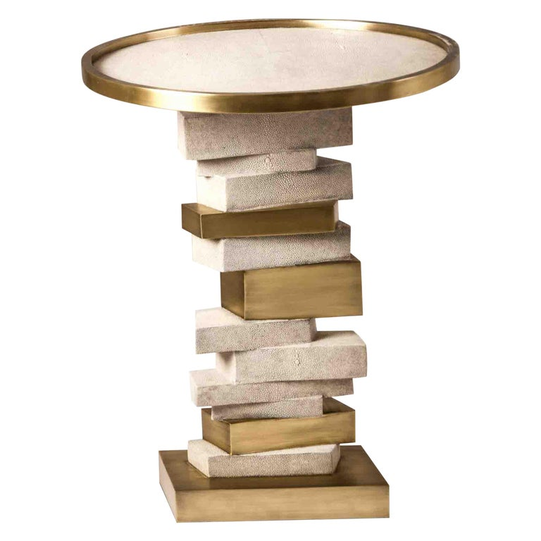 The Bullion side table is inspired by stacked gold bars. The top of the table is inlaid in black shagreen with a bronze-patina brass frame. The stacked inspired gold bars are inlaid in a mixture of shagreen and brass. This piece makes for a playful