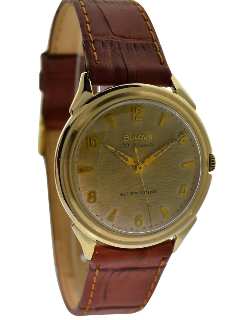 FACTORY / HOUSE: Bulova Watch Company STYLE / REFERENCE: Round / Waterproof METAL / MATERIAL: Yellow Gold Filled CIRCA: 1960's DIMENSIONS: 39mm X 35mm MOVEMENT / CALIBER: Selfwinding / 30 Jewels  DIAL / HANDS: Original with Gilt Finish and