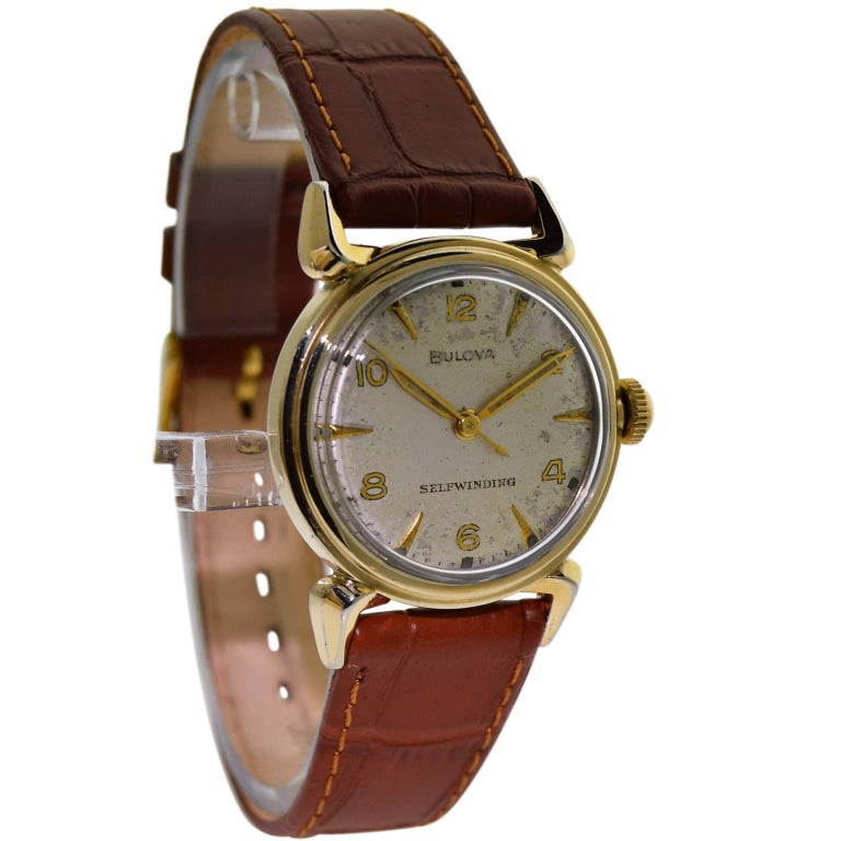 FACTORY / HOUSE: Bulova Watch Company STYLE / REFERENCE: Round / Art Deco METAL / MATERIAL: 14Kt. Yellow Gold Filled CIRCA: 1960's DIMENSIONS: 40mm X 31mm MOVEMENT / CALIBER: Selfwinding /17 Jewels  DIAL / HANDS: Original Silvered Quartered /