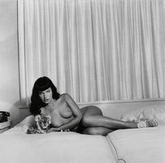 Bettie Page on Couch Nude with Stuffed Tiger
