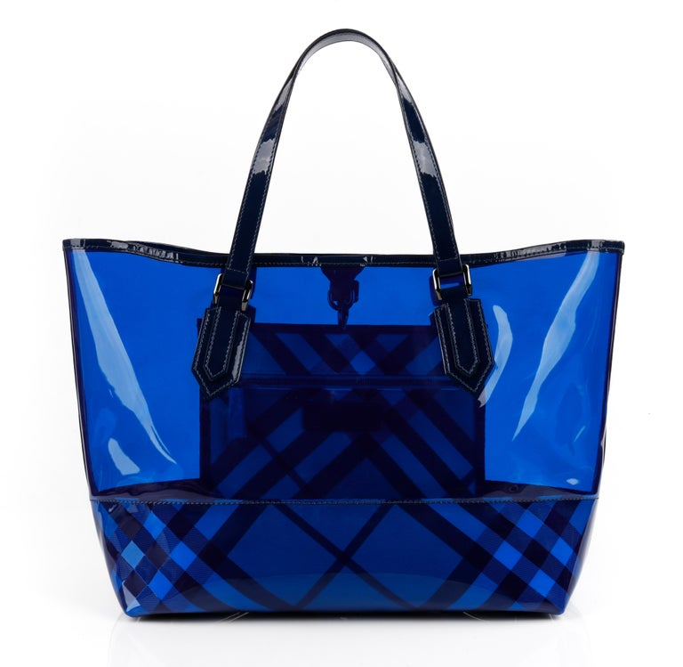 "BURBERRY ""All Over Perspex"" Jet Blue Transparent PVC Tote Bag + Pouch   Estimated Retail: $695  Brand / Manufacturer: Burberry Manufacturer Style Name: All Over Perspex Tote Style: Tote Bag Color(s): Jet Blue Marked Materials: Exterior: 100% PVC;"