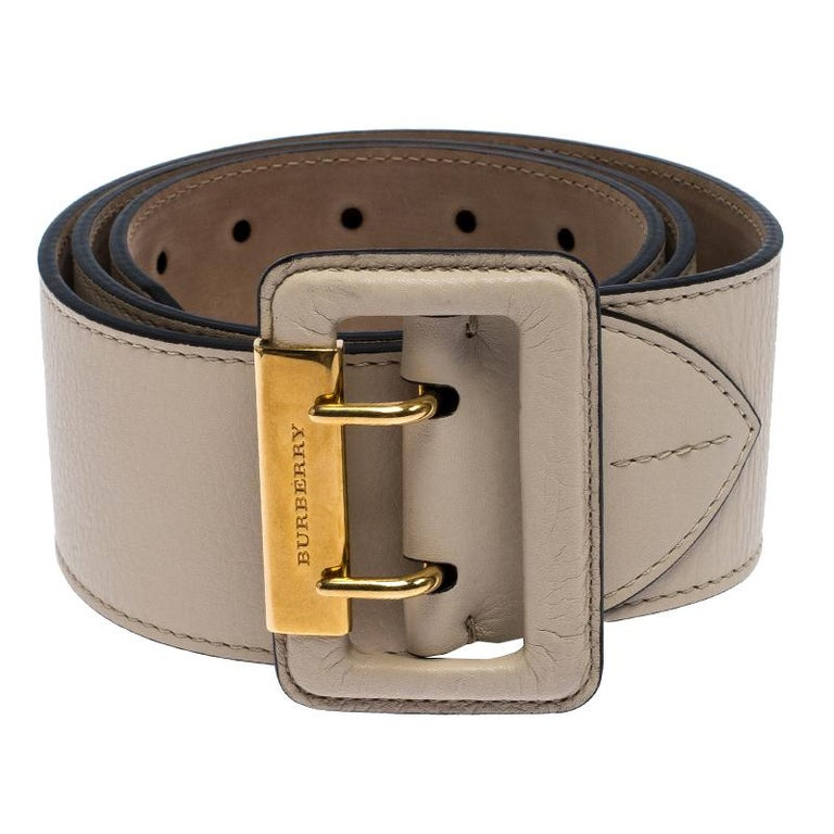 Accessorise right with this lovely waist belt from Burberry. It is beautifully made from leather and detailed with a double pin buckle. The beige Cecile belt can be worn to cinch skirts and dresses.  Includes: Original Dustbag, Price Tag