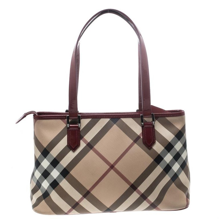5d1222be9ceb Burberry s Nickie tote is chic and smart. Crafted from classic Nova Check  PVC and styled