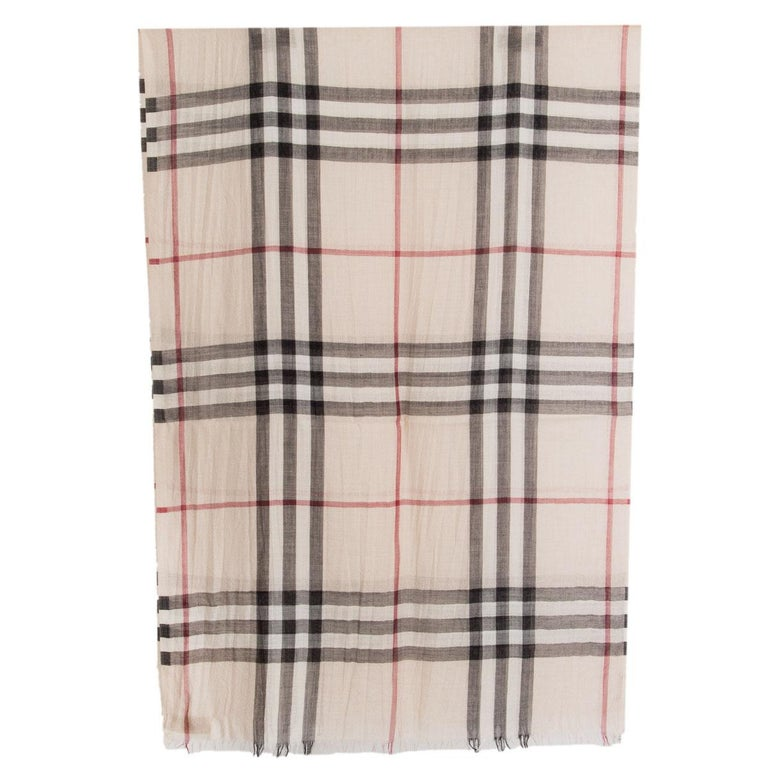 100% authentic Burberry classic check shawl in light beige, black and red virgin wool (51%) and silk (49%). Has been worn and is in excellent condition.  Height70cm (27.3in) Length220cm (85.8in)  All our listings include only the listed item