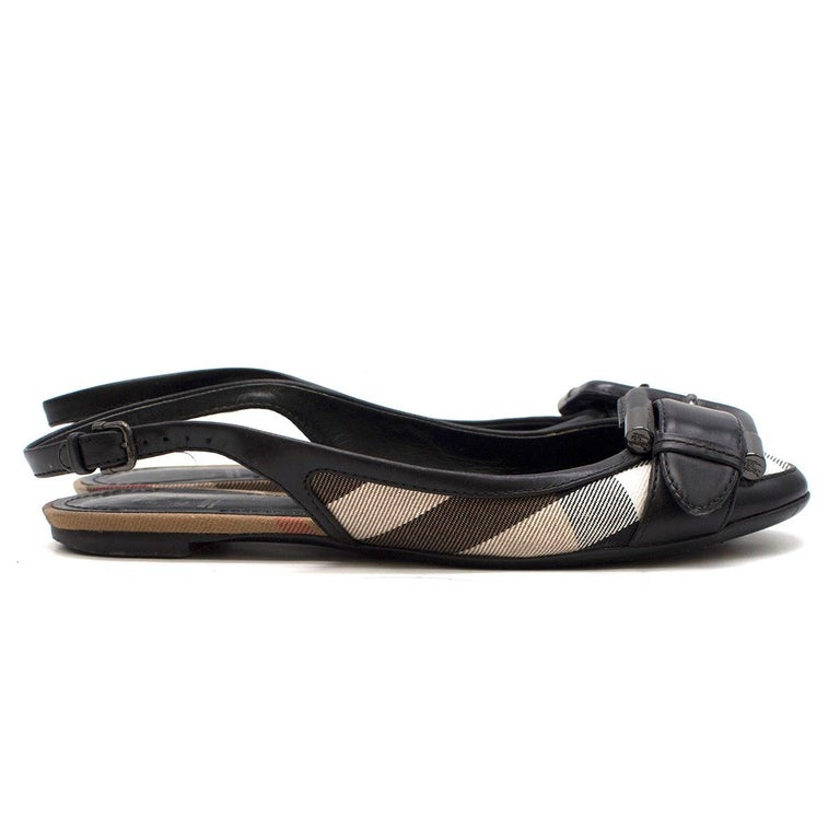 Burberry Black Leather Check Buckle Slingback Flats  - Canvas check-patterned flats - Leather trim - Black leather front buckle - Adjustable slingback - Round-toe - Leather and check canvas insole - Very low heel  Please note, these items are