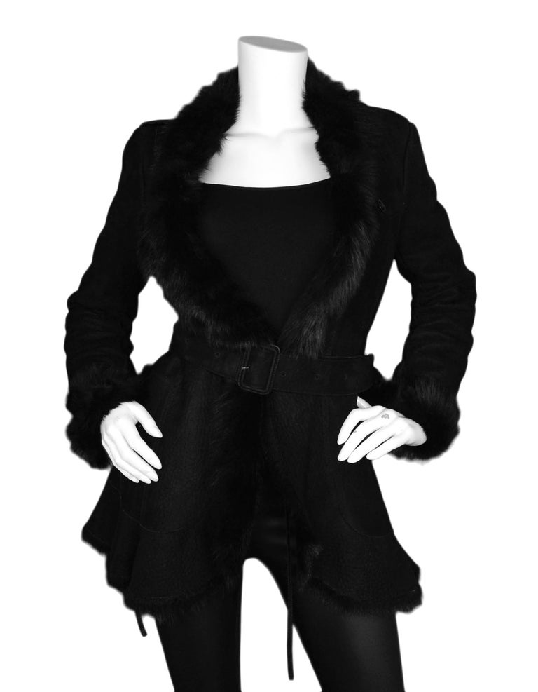 Burberry Black Shearling Belted Coat W/ Fur Trim Sz 4  Made In: Italy Color: Black Materials: 100% sheepskin Lining: Black fur Opening/Closure: Internal tie at center and belt on outside Overall Condition: Excellent pre-owned condition   Tag Size: