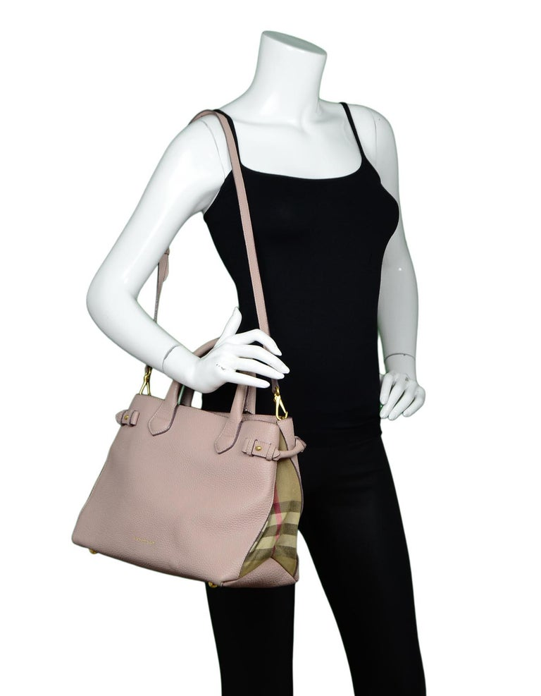 Burberry Blush Leather/House Check Canvas Medium Banner Tote Bag W/ Strap  Made In: Italy Color: Blush, tan, brown, red Hardware: Goldtone Materials: Leather, canvas Lining: Black textile Closure/Opening: Open top with three internal sections with