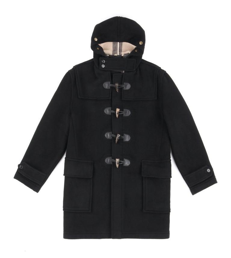 "BURBERRY Brit A/W 2013 ""Broadhurst"" Men's Black Toggle Hooded Duffle Coat Jacket  Brand / Manufacturer: Burberry  Collection: F/W 2013 Designer: Christopher Bailey Manufacturer Style Name: ""Broadhurst"" Duffle Coat Style: Duffle coat  Color(s): Black"