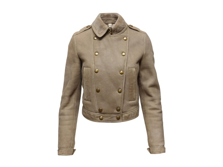 Product details: Beige double-breasted shearling jacket by Burberry Brit. Foldover collar. Dual pockets at hips. Gold-tone button closures at front. Designer size UK6. 24