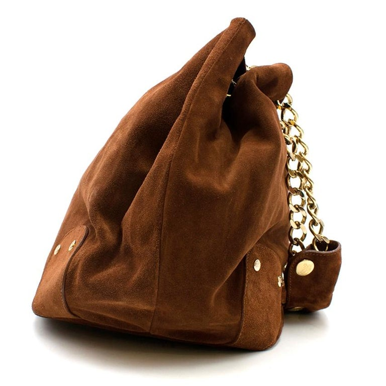 Burberry Brown Suede Bucket Shoulder Bag  - Chocolate brown suede bucket bag - Gold-tone metal chain shoulder straps with matching brown suede shoulder pads for comfort which can be removed if desired - Gold-tone hardware - Metal logo on the front -