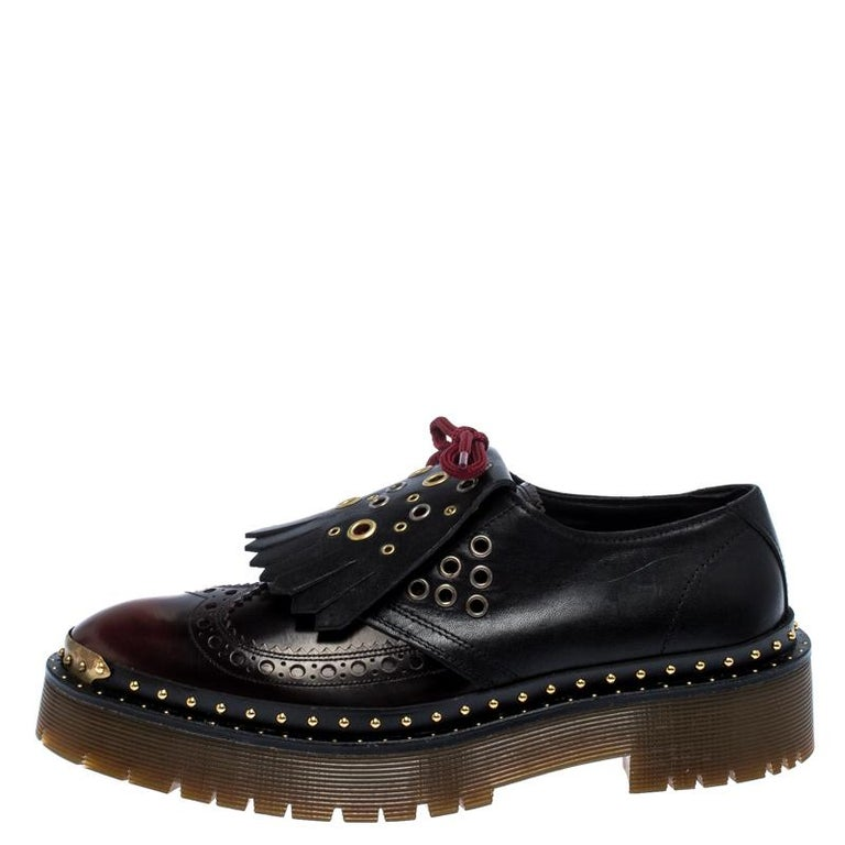 Ready to offer comfort and style, this pair of sneakers by Burberry will make a fantastic addition to your shoe collection. They've been crafted from burgundy leather and styled with ties and fringe details on the uppers. Studs and platforms