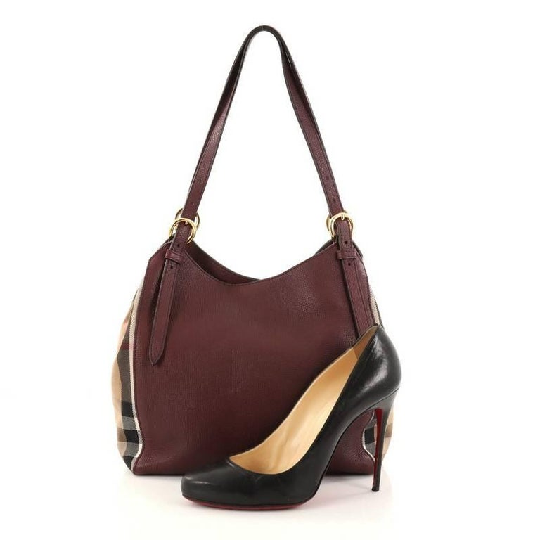 27aba6b682f1 This authentic Burberry Canterbury Tote Leather and House Check Canvas Small  is perfect for casual wear