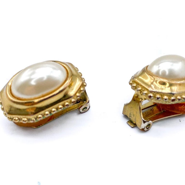 Burberry Vintage 1980s Clip on Earrings  Detail -Made in UK in the 1980s -Crafted from gold plated metal and set with faux pearls -Come with original packaging   Size & Fit -Length 0.75 inches  -Width 0.25 inches -Clip on fastening with original