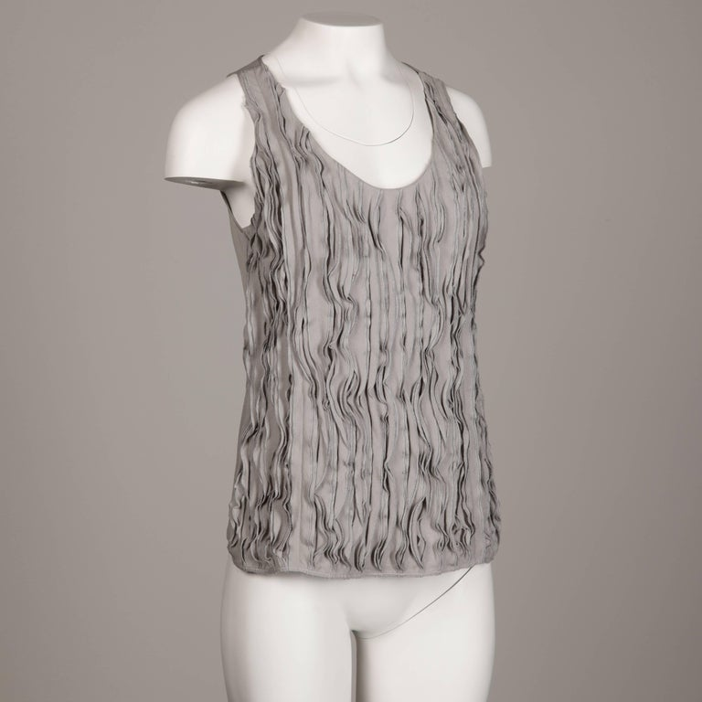 Recent Burberry tank top with a ruffled design in front. 100% silk fabric with side zip and hook closure. Marked size is USA 4/ UK 6 and fits like a modern size small. The bust measures 35