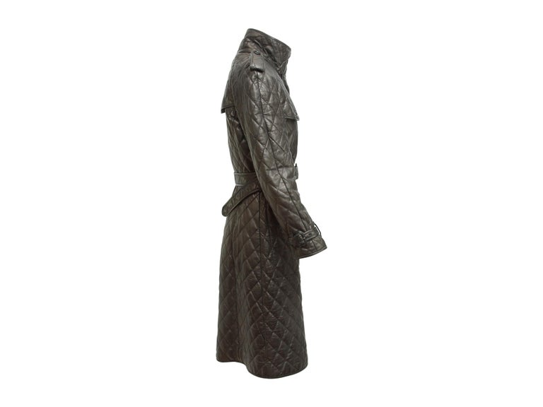 Product details:  Black Leather Burberry London Quilted Trenchcoat. Fall just got chic-er! This Burberry London quilted trenchcoat is belted, has a standup collar and  two flap front pockets.  Button front closure.  Size IT 38, 4. Measurements: 37