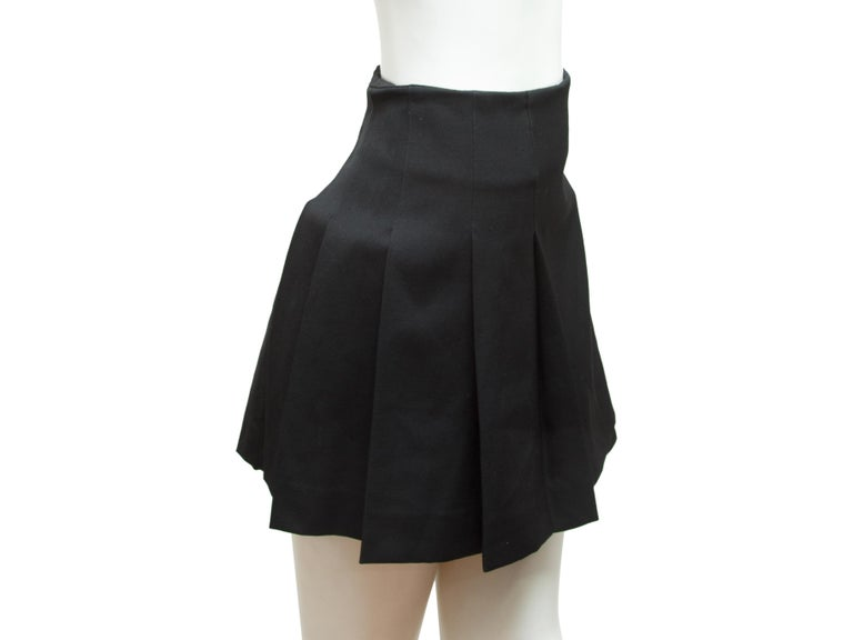 Product details:  Black kilt skirt by Burberry London.  Side double buckle closure.  Pleated back.  Frayed trim.  30