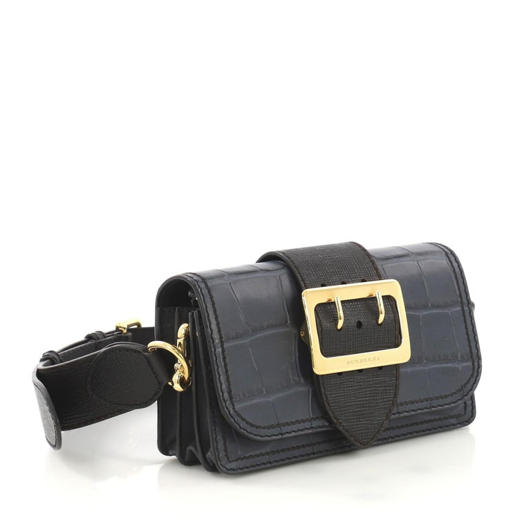 9ddbbb4590 This Burberry Madison Buckle Flap Bag Crocodile Embossed Leather Medium,  crafted in blue crocodile embossed