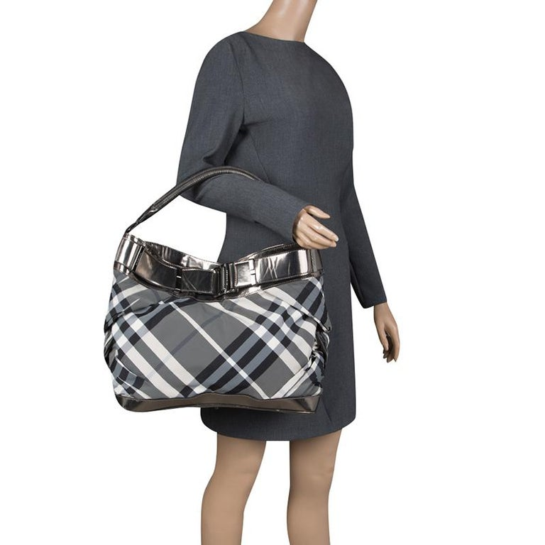 59bc253d47fe Burberry Metallic Grey Beat Check Nylon and Leather Shoulder Bag For Sale.  Fashioned in the label s signature Check pattern