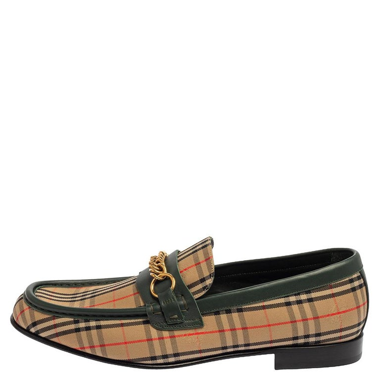 Stylish and super comfortable, these slip-on loafers by Burberry will make a great addition to your shoe collection. They have been designed using the signature Nova Check canvas and leather and styled with round toes and gold-tone chain-link
