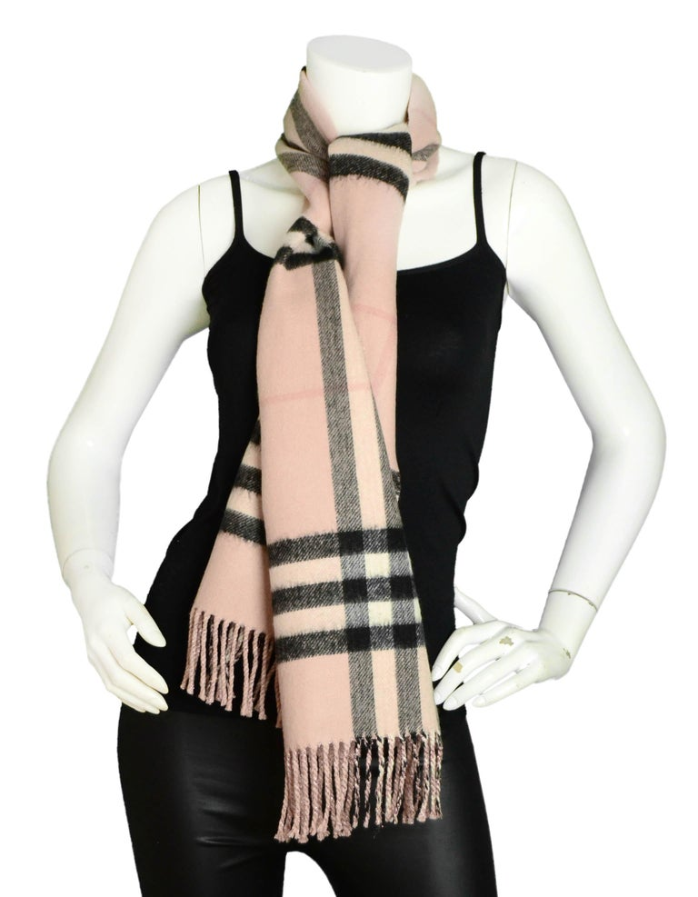 """Burberry Pink/Black Plaid & Glitter Cashmere Blend Scarf  Made In: Scotland Color: Pink & black Materials: 80% cashmere, 13% polyester, 7% metallic fiber Overall Condition: Very good - light staining throughout  Measurements:  12.5""""W x 65""""H"""