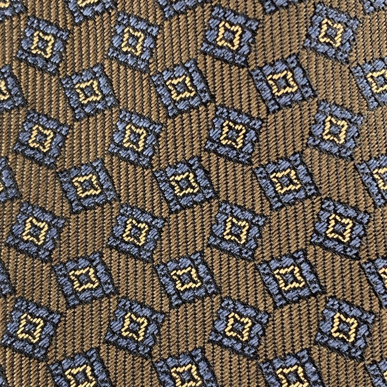 Burberry Prorsum skinny tie comes in taupe brown silk with navy geometric squares print.  Made in England.    New with Tag.   Width: 2 in.