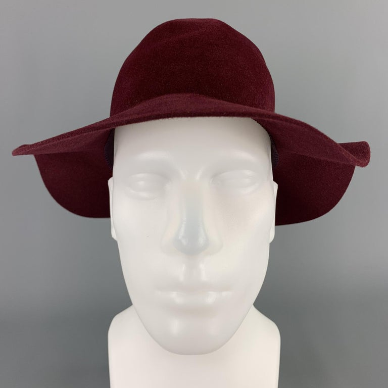 BURBERRY PRORSUM Spring 2015 hat comes in a burgundy rabbit felt featuring a fedora style detailed with a contrasting grosgrain band and softly structured. Made in Italy.  Excellent Pre-Owned Condition. Marked: M  Measurements:  Opening: 16 in.
