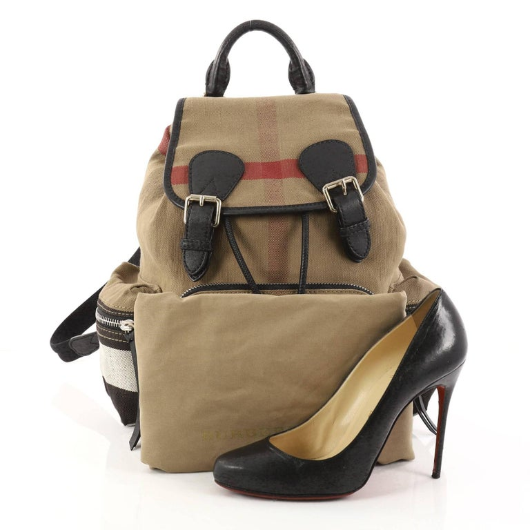This authentic Burberry Rucksack Backpack House Check Canvas Medium is a  bag that pulls off a 528809a40a982