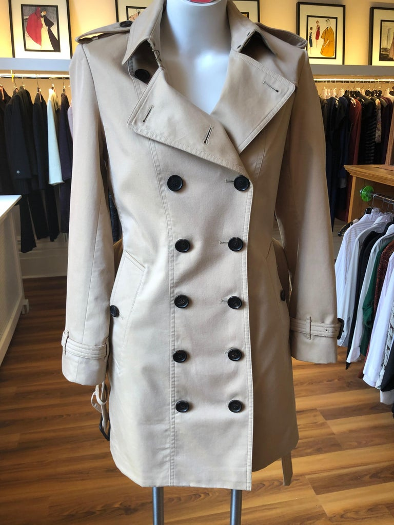 The Sandringham is one of the three Burberry Heritage Collection trench  coats. It is made of water repellent cotton gabardine. It is a tailored-fit trench coat which is cut to contour the body for a streamlined look.  It is a classic all season