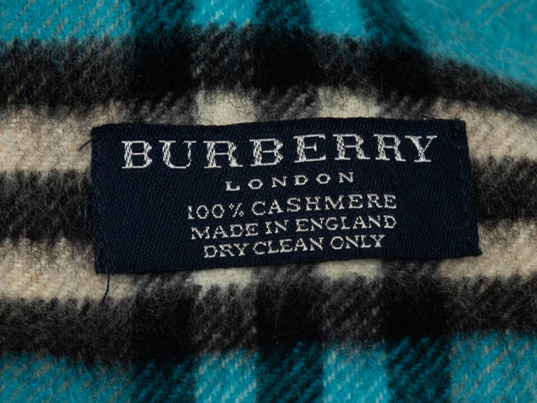 Product details: Teal, black and white cashmere scarf by Burberry. Nova Check pattern throughout. Fringe trim at ends. 56