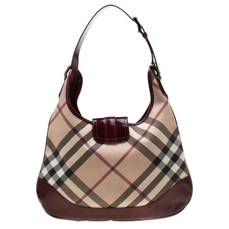 Step out in style with this version of Brooke hobo from the British luxury fashion house of Burberry. Designed in classic nova check PVC the bag features a single leather handle and a front flap closure. It has a roomy fabric lined interior that