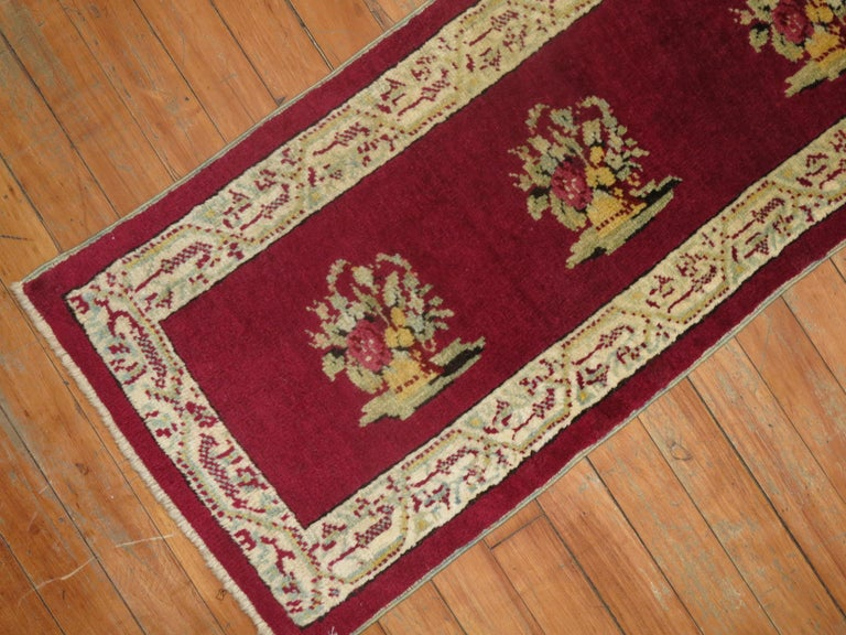 Horizontally woven burgundy color Turkish rug from the early 20th century.