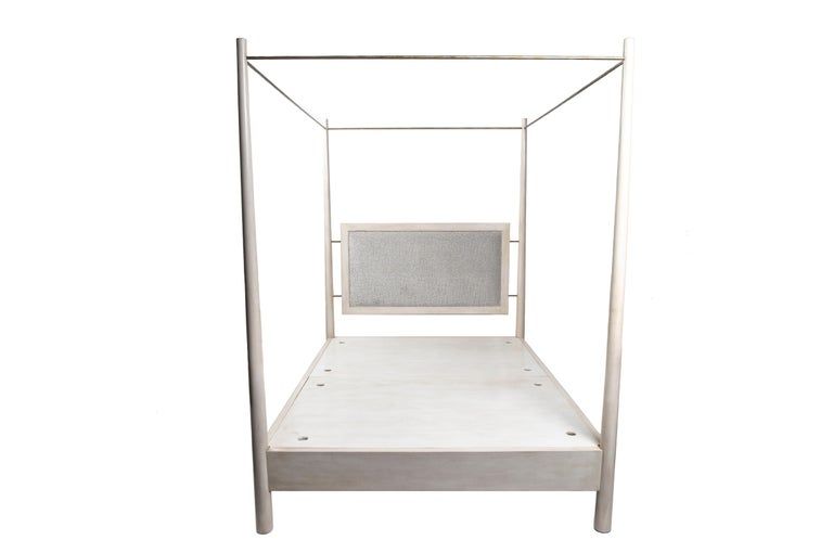 An effortless blend of wood, metal and fabric make the Burkley bed a refreshingly lighter take on traditional canopy beds. The metal rods are scaled to be minimalistic while their modular make can accommodate mesh fabric or small string lights for a