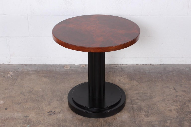 A large scale side table with burl top and ebonized base. Attributed to Edward Wormley for Dunbar.