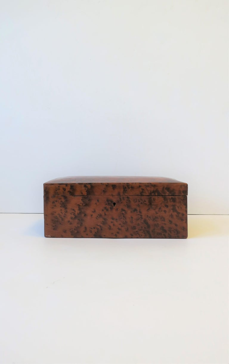 A beautiful Minimalist or organic modern rich burl wood vanity or desk box, circa 20th century. A great box for many different items including jewelry (as demonstrated.)   Measurements include: 3.78
